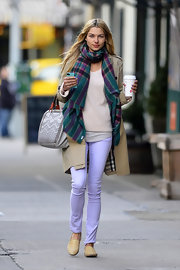 Jessica Hart chose a plaid tartan-style scarf for her bright and colorful look while out in NYC.