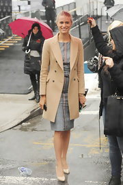 Julie Henderson looked polished and sophisticated in a tan wool coat.