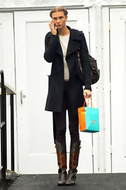 Karlie Kloss looked tough-chic in her two-tone knee-high boots and wool coat during Mercedes-Benz Fashion Week.
