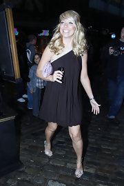 Liz Mcclarnon looked perfectly put together in her one-shoulder LBD, silver sandals, and romantic 'do.