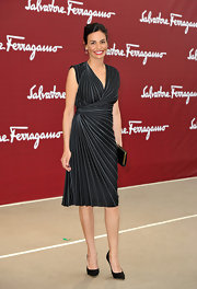 Ines attended the Ferragamo fashion show in a sleek striped pattern wrap dress.