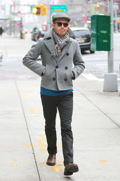 This short gray pea coat was a clean and suave choice to keep Jesse Tyler Ferguson warm.