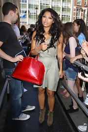 Vanessa White showed off her red embossed handbag while attending BBC 1 radio in London.