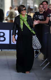 Frankie dressed up a basic black maxi dress with a leather jacket and vibrant green scarf.