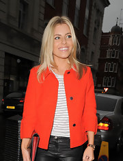 Mollie King was a bright pop of color on the streets of London in a deep orange cropped jacket.