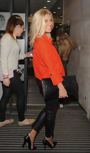 Mollie King accessorized with an oversized black leather clutch during a visit to the BBC Radio 1 studio.