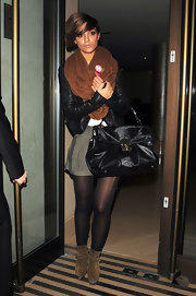 Frankie Sandford added a touch of fall color into her street wear with a snuggly brown snood.