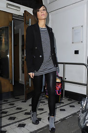 Frankie Sandford finished off her boyish ensemble with a pair of gray suede ankle boots with black patent cap toes.