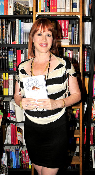 Molly Ringwald looked youthful in her black mini skirt and striped blouse.