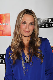 Model Molly Sims showed off her long honey-blond curls while attending Nouveau Cirque in New York.