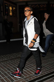 Red-laced Nike sneakers added a touch of color to Jaden Smith's look.