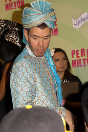 Perez Hilton celebrated his birthday looking exotic in a blue turban and a matching top.