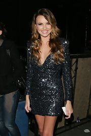 Nadine Coyle looked marvelous in a black sequined mini dress while out and about in London.