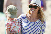 Naomi Watts and Liev Schrieber continue their sunny Christmas vacation with a visit to Bronte Beach, Sydney, with sons Sasha (striped t-shirt) and Samuel (red shorts). The happy family have escaped the freezing New York winter for a festive break with Naomi's family Down Under. Naomi first met with a gal pal and her baby, before they were met by Liev for some rockpooling adventures. At one stage, poor Liev took a tumble on the rocks, but managed to save eldest son Sasha from harm as he fell.