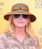 Kathy Hilton completed her summery ensemble at the Veuve Clicquot Polo Classic with a brown straw hat.