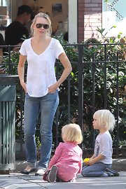 Actress Naomi Watts wore a Little Athens tee in white burnout while playing with her children at East Village Park.
