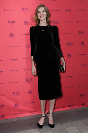 Natalia looked retro-chic in this black velvet peplum skirt suit.