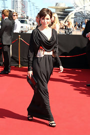 Danni Minogue wore a black draped gown with a statement copper belt for the ARIA Awards.