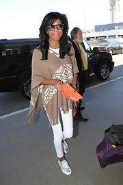 Natalie Cole sported a cool Southwestern-inspired brown poncho while leaving LA.