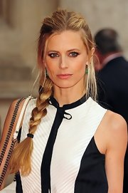 Laura Bailey collected her hair into a sleek side braid for a visit to the Victoria and Albert Museum in London.