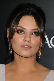 Mila Kunis finished off her elegant updo with 19th Century gold pendant earrings.