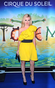 Katherine glows in a bright yellow one-shouder cocktail dress with a playful ruffle.