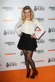 Anna Williamson was on trend in a black mini skirt and burgundy ankle boots.