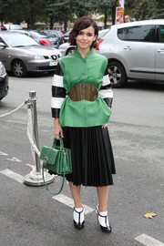 A green exotic-skin cross-body tote finished off Miroslava Duma's ensemble in elegant style.