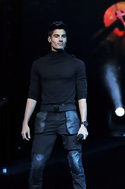 Siva Kaneswaran's turtleneck would normally look tacky, but he pulls the streamlined style off.