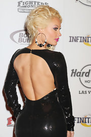 A pair of black and silver costume hoops added a modern flair to Coco's ensemble at the World MMA Awards.