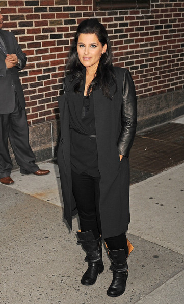 Nelly Furtado embraced the leather trend in a long wool coat with sleeves made of the sexy material.