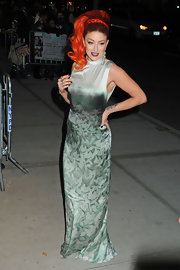Neon Hitch stood out at the 'On the Road' premiere in this silky ombre gown and fiery red hair.