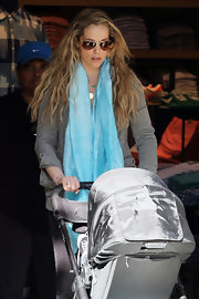 Elizabeth Berkley's look was brightened up with a baby blue scarf while walking with her son, Sky.