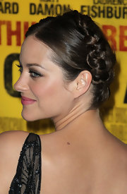 Marion Cotillard looked sweet and sophisticated at the 'Contagion' premier. To recreate her charming hairstyle, part tresses down the center and braid each side, securing with a hair elastic. To complete the look, wrap ends together at the top of the head and pin in place.