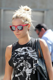 Ashley Tisdale added flair to her gym attire with cherry red wayfarer shades. She wore her newly dyed blond locks in a messy top knot.