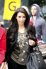 Kim is a sucker for a great statement necklace she paired her geometric blouse and tailored blazer with a silver and gold chain embellished necklace.
