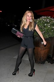 Adrienne Maloof showed off her fit body in a tight black romper during a dinner date.