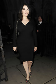 Who says long sleeves can't be sexy? Nigella proves that wrong in this slinky black dress.