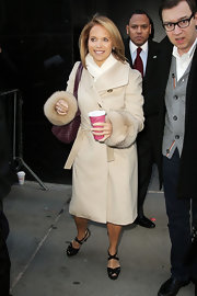 Katie Couric balanced her summery sandals with a classic camel coat with oversize fur cuffs.