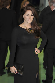 Lucy Pinder donned a simple yet sophisticated ensemble, consisting of a leather clutch and a long-sleeve dress, at the premiere of 'The Hobbit: An Unexpected Journey.'