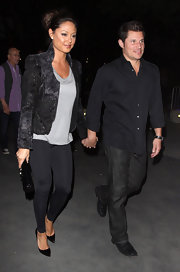 Vanessa Lachey added interest to a basic top with a futuristic pewter jacket with a high collar.