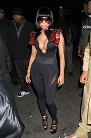 Nicki Minaj showed some serious skin in this cleavage-baring body-hugging number for the Christmas Extravaganza.