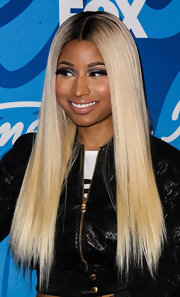 To balance out her bold eyes, Nicki opted for a subtle nude lip.