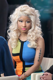 "During an appearance on 'Good Morning America,' Nicki Minaj wore a sleeveless dress that showed off her tattoo of Chinese characters, which translates as ""God Is With Me Always."""