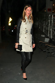 Nicky Hilton accented her evening attire with a studded black and silver clutch.