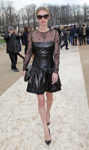 Nicky Hilton wore this girly leather and lace dress to the Valentino show in Paris.