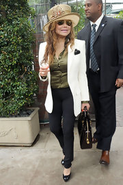 La Toya Jackson looked like a fashionable mad hatter in this cooky dress hat.