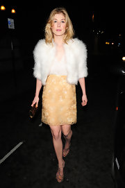 Rosamund Pike paired an Old Hollywood glam look with strappy nude sandals.