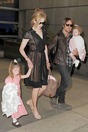 Nicole Kidman accessorized her travel look with nude slingback heels complete with floral detailing.