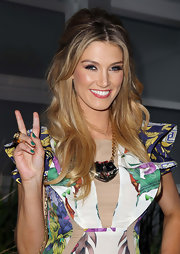 Delta Goodrem wore a divine half-up half-down 'do at the 'Voice' party in Sydney.